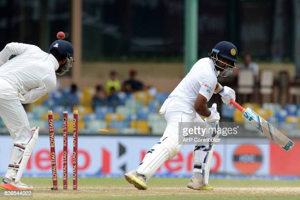 Sri Lanka's Dilruwan Perera gets dismissed by India's Ravichandran Ashwin during the third day of the second Test cricket match between Sri Lanka and...
