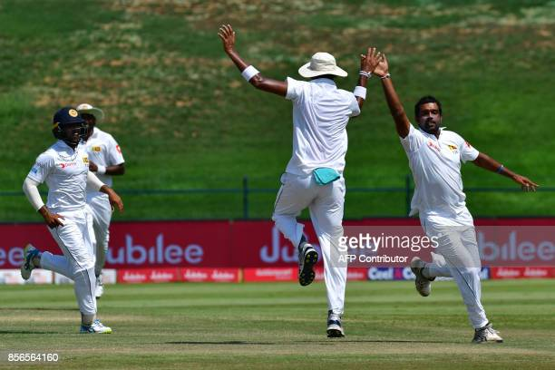 Sri Lanka's Dilruwan Perera with teammates celebrate during the fifth day of the first Test cricket match between Sri Lanka and Pakistan at Sheikh...