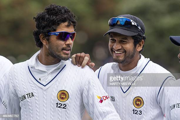 Sri Lanka's Dimuth Karunaratne and teammate Dinesh Chandimal walk from the field at tea on day one of the second international Test cricket match...