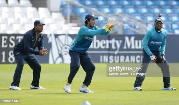 Sri Lanka's Dinesh Chandimal in action with Kumar Sangakkara and Mahela Jayawardene during a nets session at Headingley Leeds