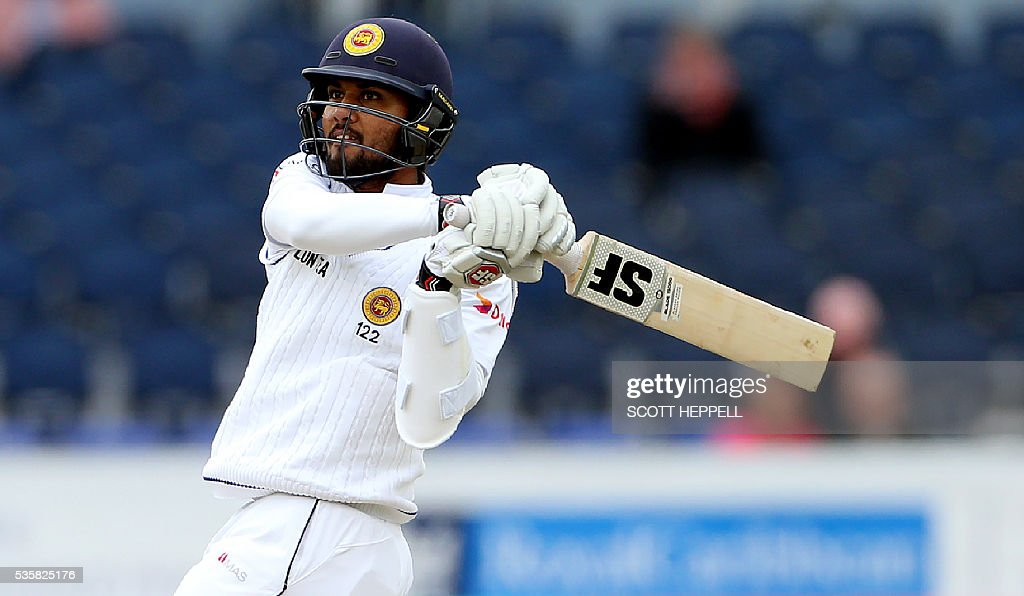 Sri Lanka's Dinesh Chandimal plays a shot on the fourth day of the second test cricket match between England and Sri Lanka at the Riverside in Chester-le-Street, north east England, on May 30, 2016. / AFP / SCOTT