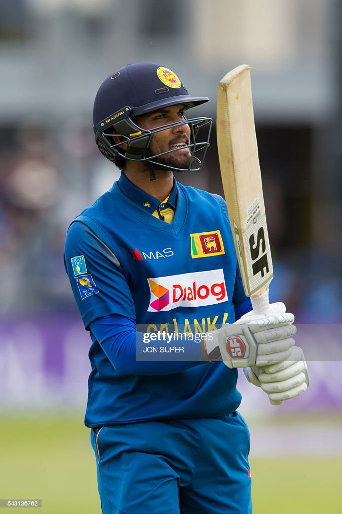 Sri Lanka's Dinesh Chandimal reacts after being caught during play in the third one day international (ODI) cricket match between England and Sri Lanka at Bristol cricket ground in Bristol, south-west England, on June 26, 2016. England captain Eoin Morgan won the toss and elected to field against Sri Lanka in the third one-day international at Bristol on Sunday. / AFP / JON