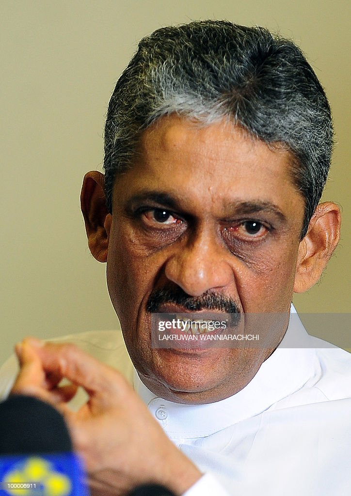 Sri Lanka's ex-army chief General Sarath Fonseka gestures as he addresses media representatives at parliament in Colombo on May 20, 2010. Heavy rains scuttled celebrations marking the Sri Lanka's defeat of Tamil rebels because of the 'unjust incarceration' of the army general responsible for the victory, his political party said. The Democratic National Alliance (DNA) of Sarath Fonseka, the top general who led troops and crushed Tamil Tiger rebels exactly a year ago is now in military detention facing two courts martial. AFP PHOTO/ Lakruwan WANNIARACHCHI