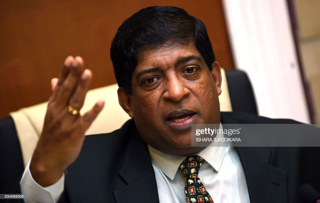 Sri Lanka's Finance Minister Ravi Karunanayake gestures as he addresses Colombo-based foreign correspondents in Colombo on May 25, 2016. Sri Lanka was banking on foreign aid to rebuild 35,000 flood-damaged homes and other infrastructure at a cost of USD 2.0 billion, the finance minister said the toll topped 100. Minister Karunanayake said the recovery from last week's deluge that caused floods in the capital Colombo and landslides elsewhere would require international support. / AFP / ISHARA