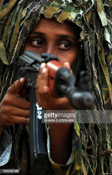 Sri Lanka's first batch of Police Special Task Force women commandos perform a drill during a passing out parade at Katukurunda some 40 kms south of...