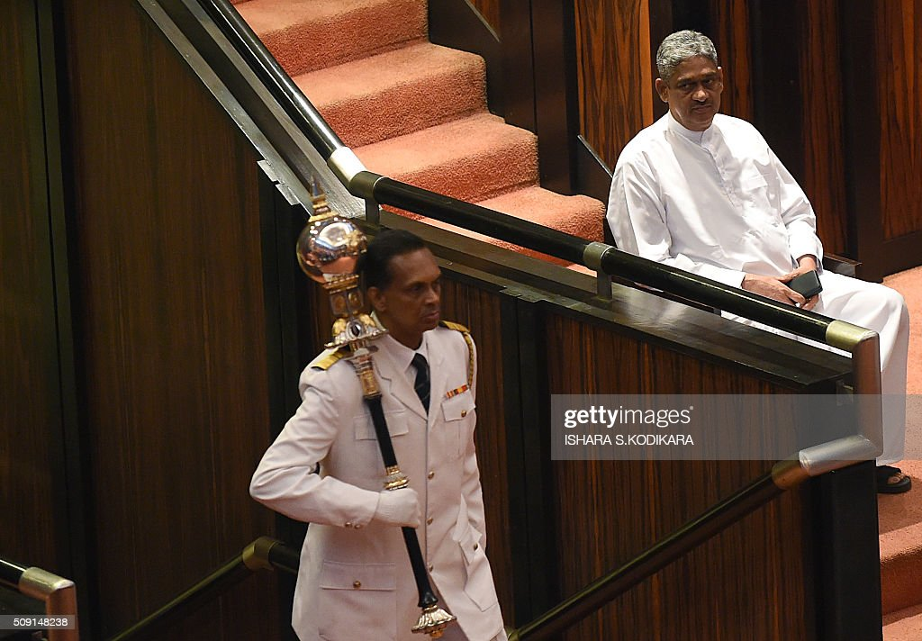 Sri Lankas former army chief Sarath Fonseka (R) is sworn in as a member of parliament in Colombo on February 9, 2016. Fonseka , who was jailed for over two and a half years by former president Mahinda Rajapakse after he unsuccessfully challenged his 2010 re-election bid, has formed a political party and joined the current ruling party. AFP PHOTO/ Ishara S. KODIKARA / AFP / Ishara S.KODIKARA