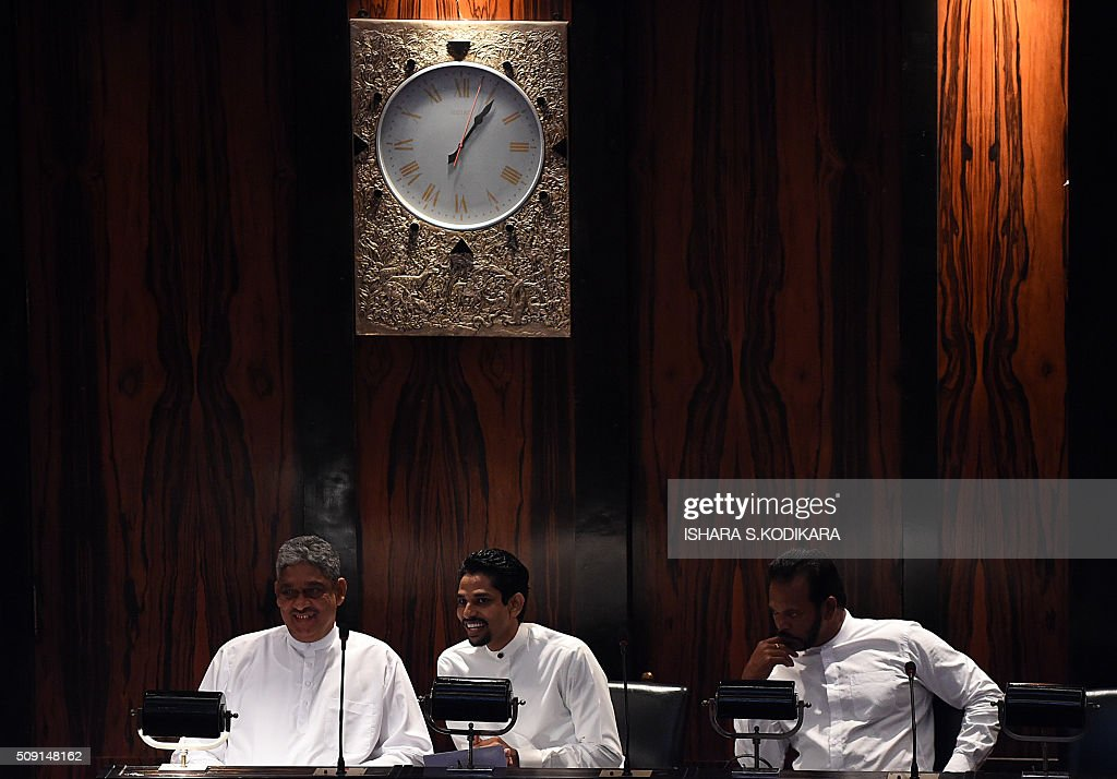 Sri Lankas former army chief Sarath Fonseka (L) looks on after he is sworn in as a member of parliament in Colombo on February 9, 2016. Fonseka , who was jailed for over two and a half years by former president Mahinda Rajapakse after he unsuccessfully challenged his 2010 re-election bid, has formed a political party and joined the current ruling party. AFP PHOTO/ Ishara S. KODIKARA / AFP / Ishara S.KODIKARA