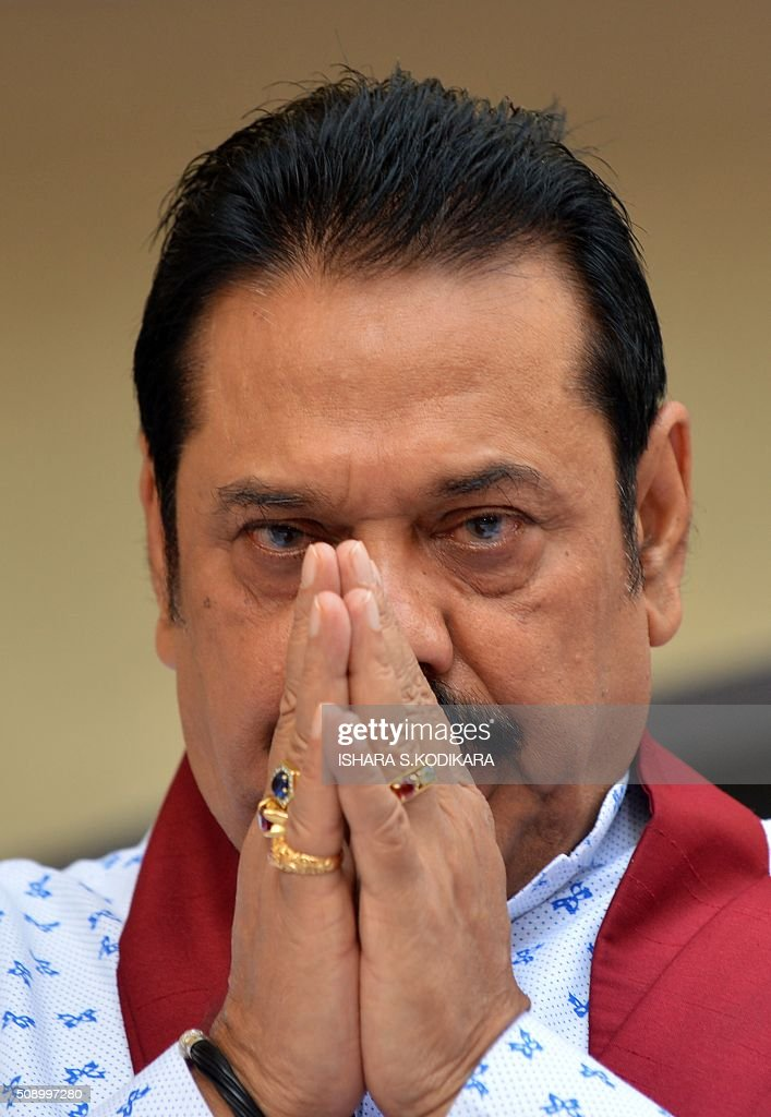 Sri Lankas former president Mahinda Rajapakse prays in Colombo on February 8, 2016 during a ceremony to petition against a UN-mandated investigation into alleged war crimes during the final stages of the islands Tamil separatist war. Former president Mahinda Rajapakse and his brother on February 8 denounced a visit by UN human rights chief Zeid Ra'ad Al Hussein to Sri Lanka as a 'big joke' and renewed their opposition to a UN-mandated war crimes probe. AFP PHOTO/ Ishara S. KODIKARA / AFP / Ishara S.KODIKARA