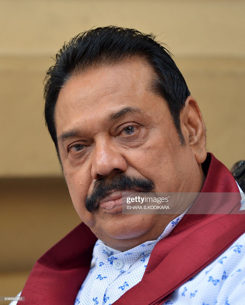 Sri Lankas former president Mahinda Rajapakse takes part in a ceremony in Colombo on February 8, 2016 to petition against a UN-mandated investigation into alleged war crimes during the final stages of the islands Tamil separatist war. Former president Mahinda Rajapakse and his brother on February 8 denounced a visit by UN human rights chief Zeid Ra'ad Al Hussein to Sri Lanka as a 'big joke' and renewed their opposition to a UN-mandated war crimes probe. AFP PHOTO/ Ishara S. KODIKARA / AFP / Ishara S.KODIKARA