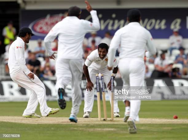 Sri Lanka's Hammika Prasad celebrates taking the wicket of England's Alastiar Cook