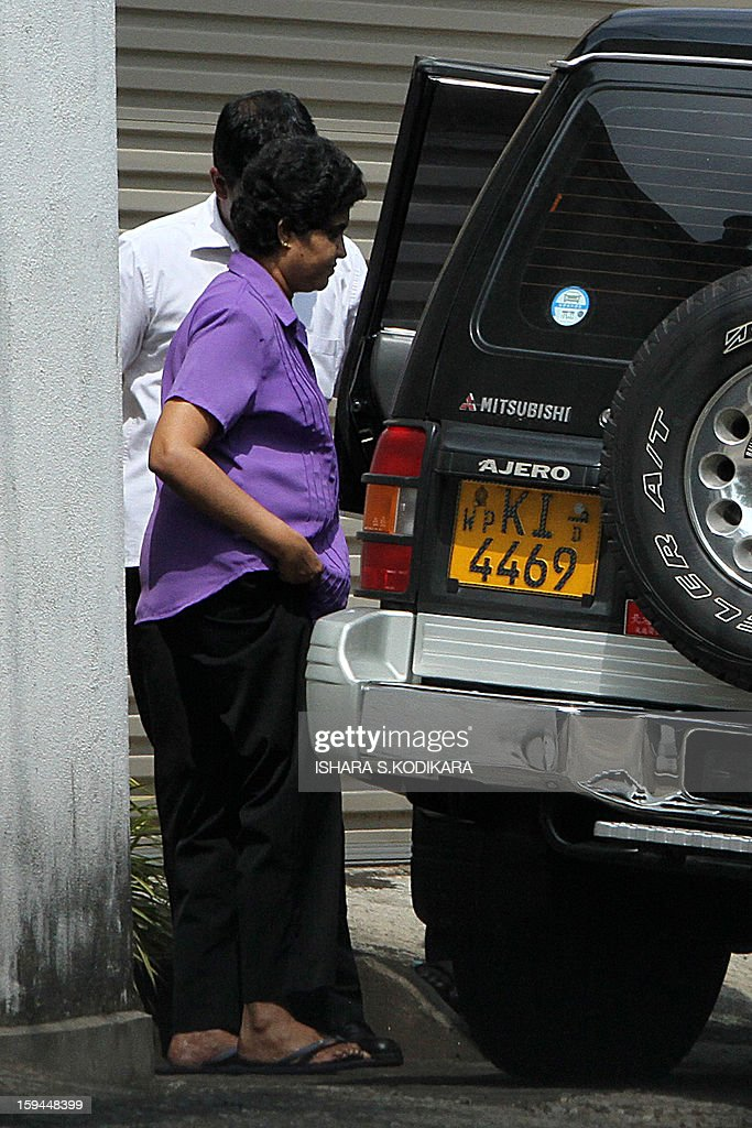 Sri lanka's impeached Chief Justice Shirani Bandaranayake steps out of her private home in Colombo on January 14, 2013, a day after President Mahinda Rajapakse sacked her. Sri Lankan President Mahinda Rajapakse sacked the chief justice by ratifying a controversial parliamentary vote, defying international calls for restraint and plunging the country into a constitutional crisis. AFP PHOTO/ Ishara S