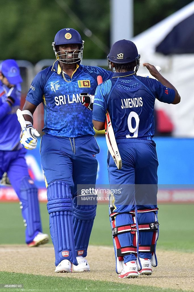 Sri Lanka's <a gi-track='captionPersonalityLinkClicked' href=/galleries/search?phrase=Jeevan+Mendis&family=editorial&specificpeople=7037737 ng-click='$event.stopPropagation()'>Jeevan Mendis</a> (R) celebrates their victory with teammate <a gi-track='captionPersonalityLinkClicked' href=/galleries/search?phrase=Thisara+Perera&family=editorial&specificpeople=4884953 ng-click='$event.stopPropagation()'>Thisara Perera</a> (C) in the Pool A 2015 Cricket World Cup cricket match between Sri Lanka and Afghanistan at University Oval in Dunedin on February 22, 2015. AFP PHOTO / MARTY MELVILLE