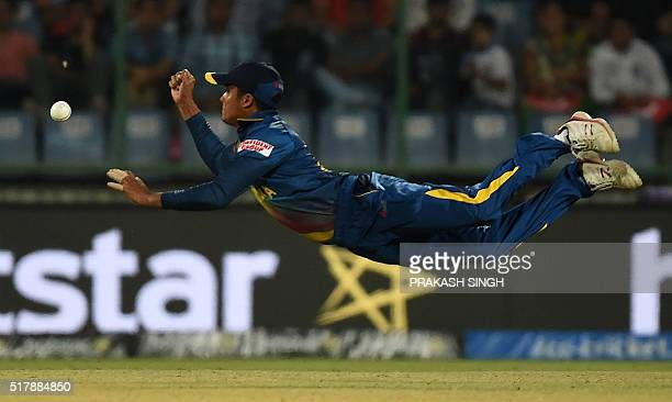 Sri Lanka's Jeffrey Vandersay drops a catch off South Africa's Hashim Amla during the World T20 cricket tournament match between South Africa and Sri...