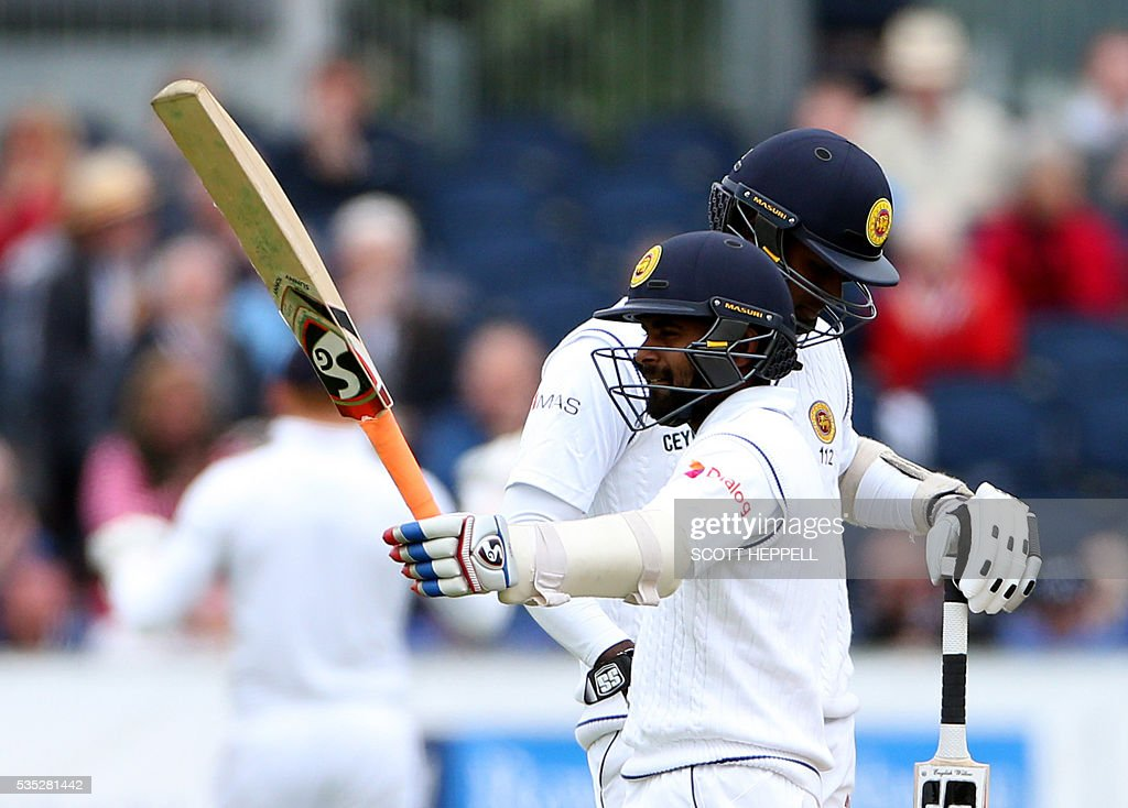 Sri Lanka's Kaushal Silva celebrates after scoring 50 on the third day of the second test cricket match between England and Sri Lanka at the Riverside in Chester Le Street, north east England on May 29, 2016. / AFP / SCOTT