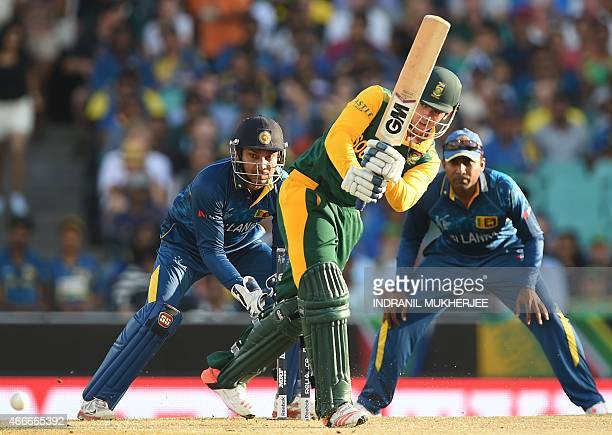 Sri Lanka's Kumar Sangakkara and Mahela Jayawardene look on as South Africa's Quinton de Kock plays a shot during the 2015 Cricket World Cup...