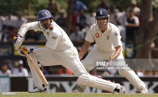 Sri Lanka's Kumar Sangakkara bats watched by England's Alastair Cook during the first Test match at Asgiriya International Stadium Kandy