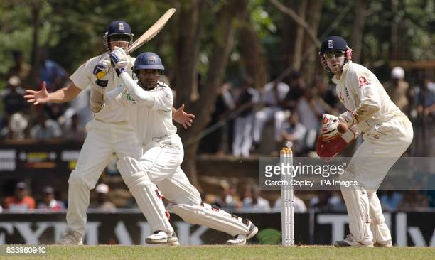 Sri Lanka's Kumar Sangakkara bats watched by England's Alastair Cook and Matthew Prior during the first Test match at Asgiriya International Stadium...