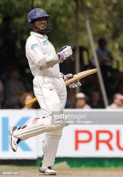 Sri Lanka's Kumar Sangakkara celebrates reaching his century during the first Test match at Asgiriya International Stadium Kandy