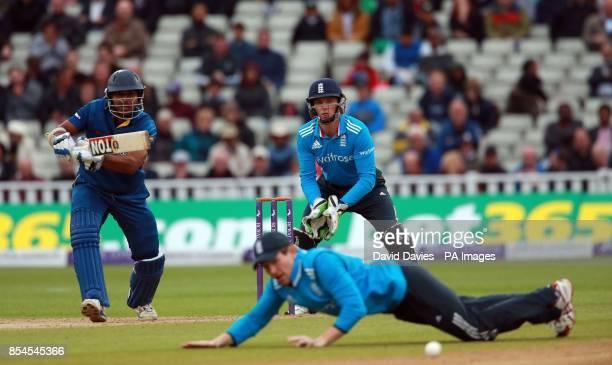 Sri Lanka's Kumar Sangakkara gets the ball past England's Eoin Morgan during the One Day International at Edgbaston Birmingham