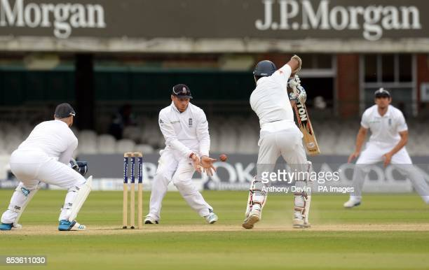 Sri Lanka's Kumar Sangakkara hits a shot past England's Ian Bell during day five of the Investec Test match at Lord's Cricket Ground London
