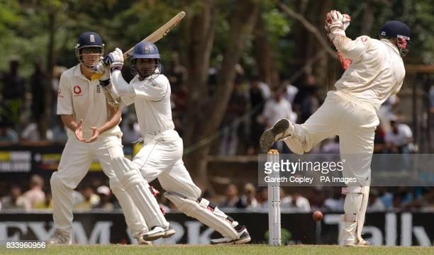 Sri Lanka's Kumar Sangakkara hits past England wicketkeeper Matthew Prior during the first Test match at Asgiriya International Stadium Kandy