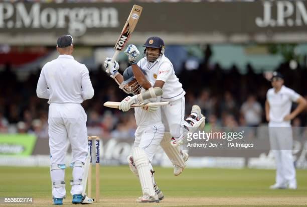 Sri Lanka's Kumar Sangakkara is congratulated by Mahela Jayawardene scoring his first century at Lord's during day three of the Investec Test match...