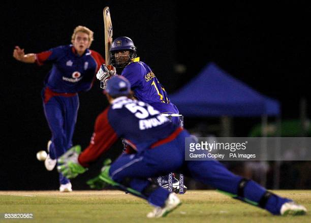 Sri Lanka's Kumar Sangakkara looks back after edging the ball into the hands of England wicketkeeper Phil Mustard during the Second One Day...