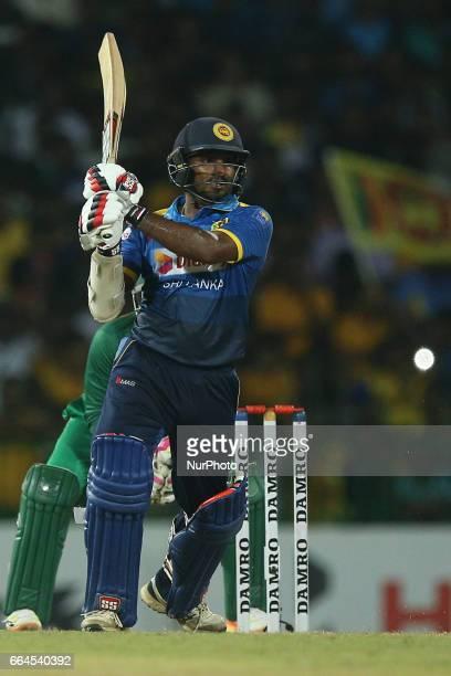 Sri Lanka's Kusal Janith Perera plays a shot during the first Twenty20 cricket match between Bangladesh and Sri Lanka in Colombo Sri Lanka Tuesday...