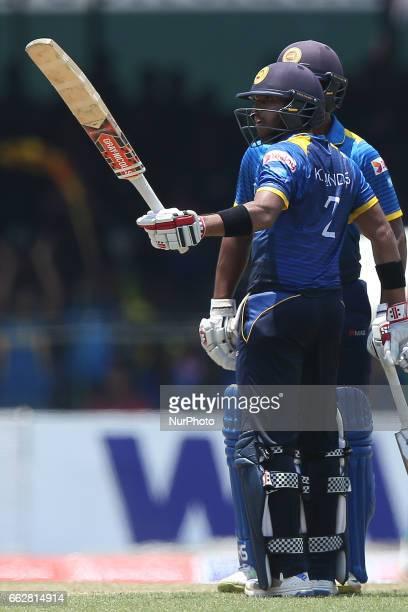 Sri Lanka's Kusal Medis acknowledges the crowd after scoring fifty runs during the third oneday international cricket match between Sri Lanka amp...
