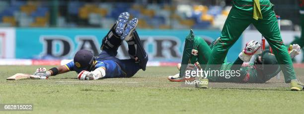 Sri Lanka's Kusal Mendis amp Bangladesh's Mushfiqur Rahim during the third and final one day international cricket match between Sri Lanka and...