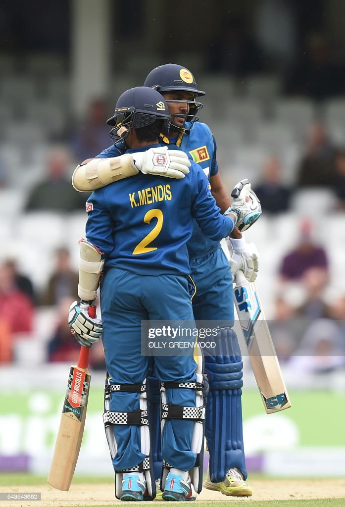 Sri Lanka's Kusal Mendis (L) is congratulated on reaching his 50 by Sri Lanka's Danushka Gunathilaka during play in the fourth One Day International (ODI) cricket match between England and Sri Lanka at The Oval cricket ground in London on June 29, 2016. England captain Eoin Morgan elected to field after winning the toss in the fourth one-day international against Sri Lanka at The Oval on Wednesday. With light rain around and dark grey skies, Morgan clearly felt his bowlers could utilise the favourable bowling conditions with further down pours forecast during the afternoon and evening. ECB