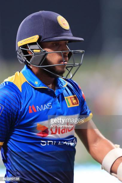 Sri Lanka's Kusal Mendis leaves the field after being dismissed by Pakistan's Hassan Ali during the second one day international cricket match...