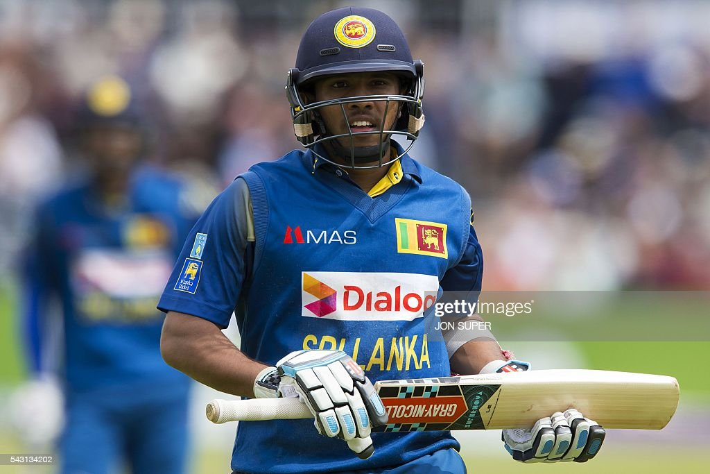 Sri Lanka's Kusal Mendis leaves the field after losing his wicket for 53 runs to England's Alex Hales, off the bwling of England's Liam Plunkett, during play in the third one day international (ODI) cricket match between England and Sri Lanka at Bristol cricket ground in Bristol, south-west England, on June 26, 2016. / AFP / JON