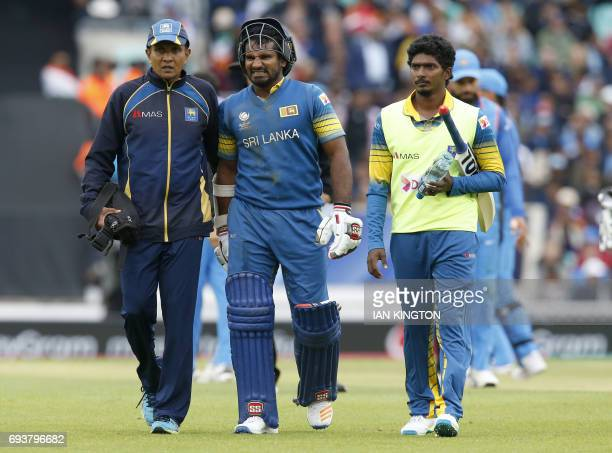 Sri Lankas Kusal Perera gestures as he retires from the game with an injury during the ICC Champions Trophy match between India and Sri Lanka at The...