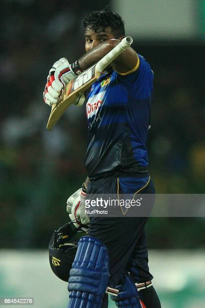 Sri Lanka's Kusal Perera looks on as he walks off after being dismissed during the first Twenty20 cricket match between Bangladesh and Sri Lanka in...