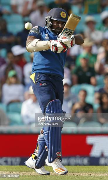 Sri Lankas Kusal Perera plays a shot during the ICC Champions Trophy match between South Africa and Sri Lanka at The Oval in London on June 3 2017 /...