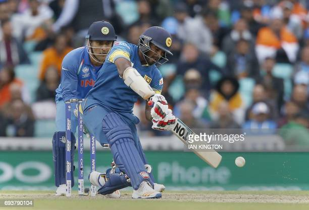 Sri Lankas Kusal Perera plays a shot during the ICC Champions Trophy match between India and Sri Lanka at The Oval in London on June 8 2017 / AFP...