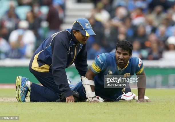 Sri Lankas Kusal Perera receives medical treatment on the pitch during the ICC Champions Trophy match between India and Sri Lanka at The Oval in...