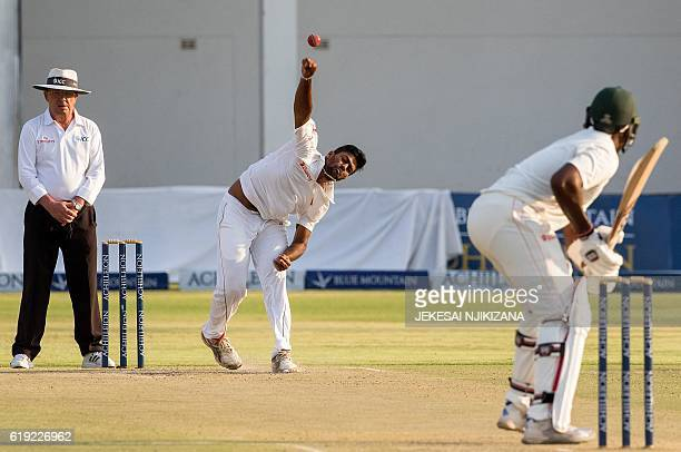 Sri Lanka's Lahiru Kumara bowls during the second day's play in the first cricket Test match between Sri Lanka and hosts Zimbabwe at the Harare...