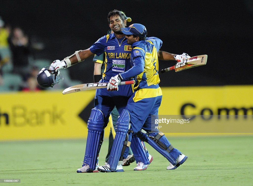 Sri Lanka's Lahiru Thirimanne (L) celebrates his 100 runs with Kushal Perera to win the game against Australia during their one-day international cricket match at the Adelaide Oval on January 13, 2013. AFP PHOTO / David Mariuz USE
