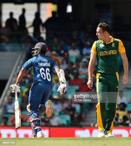 Sri Lanka's Lahiru Thirimanne runs as South Africa's Dale Steyn looks on during the 2015 Cricket World Cup quarterfinal match between South Africa...