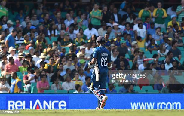Sri Lanka's Lahiru Thirimanne walks off after being dismissed during the 2015 Cricket World Cup quarterfinal match between South Africa and Sri Lanka...