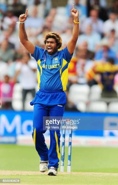 Sri Lanka's Lasith Malinga celebrates after bowling New Zealand's Aaron Redmond caught Muttiah Muralitharan for 29 during the ICC World Twenty20...