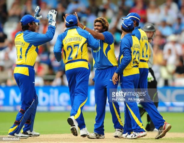 Sri Lanka's Lasith Malinga celebrates after bowling New Zealand's Aaron Redmond caught by Muttiah Muralitharan for 29 during the ICC World Twenty20...