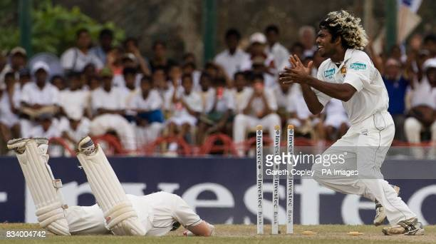 Sri Lanka's Lasith Malinga celebrates as England's Ian Bell is ran out by Tillakaratne Dilshan for 1 run during Third Test match at Galle...