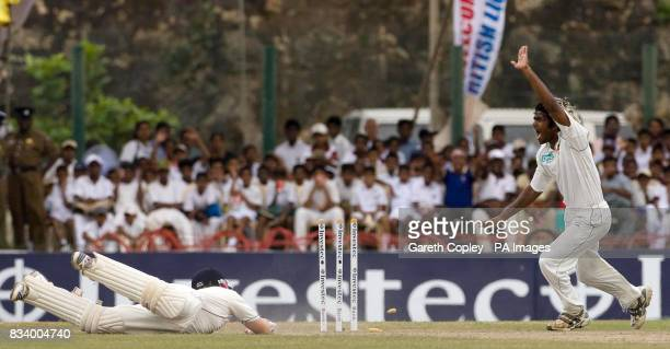 Sri Lanka's Lasith Malinga celebrates as England's Ian Bell is run out by Tillakaratne Dilshan for 1 run during Third Test match at Galle...