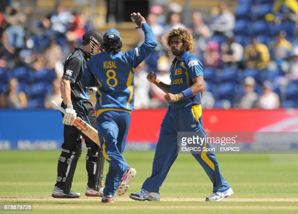 Sri Lanka's Lasith Malinga is congratulated by his team mate Kusal Perera after taking the wicket of New Zealand's Kane Williamson during the ICC...