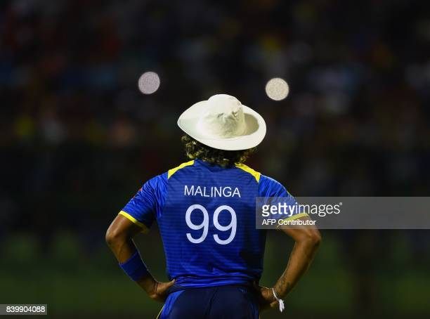 Sri Lanka's Lasith Malinga looks on during the third one day international cricket match between Sri Lanka and India at the Pallekele International...