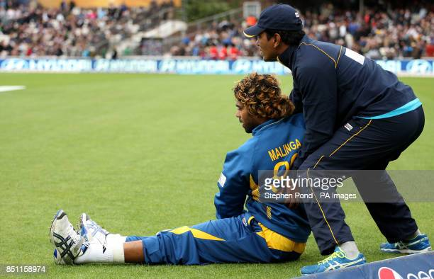 Sri Lanka's Lasith Malinga receives treatment during the ICC Champions Trophy match at The Kia Oval London