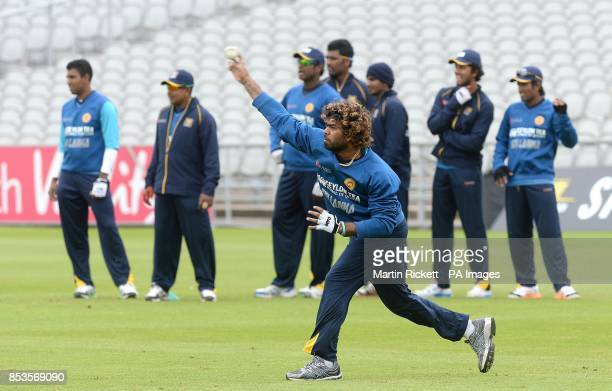Sri Lanka's Lasith Malinga throws at the stumps during the nets practice session at Old Trafford Cricket Ground Manchester